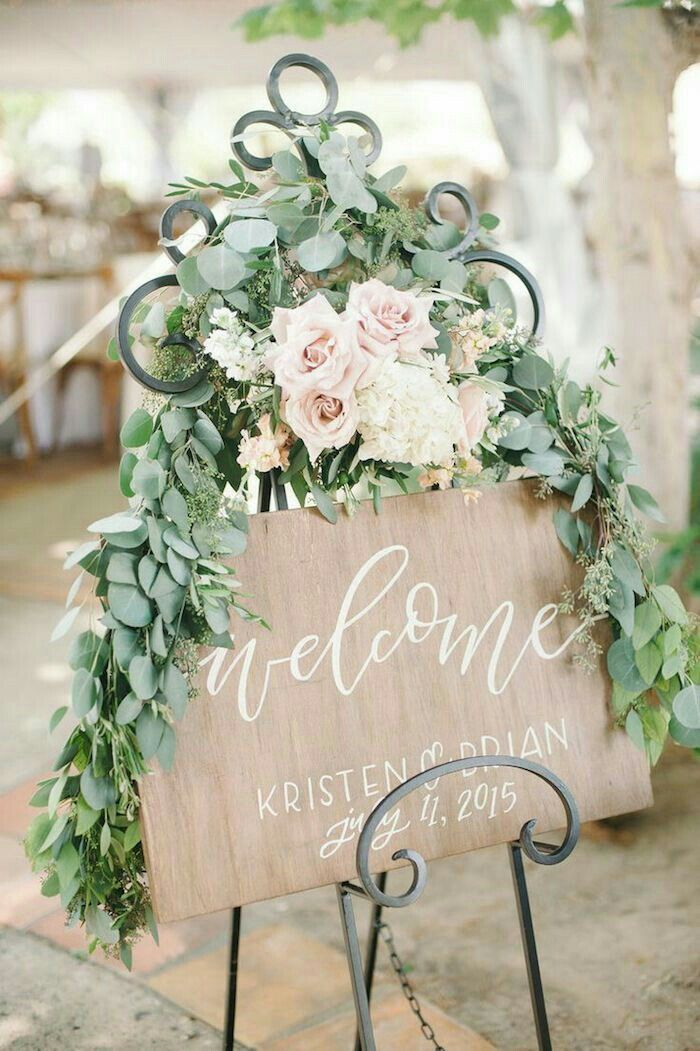 Wedding signage with flowers
