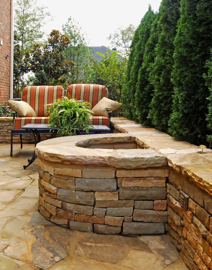 Half circle stacked stone firepit with attached seating for Fireplace half stone