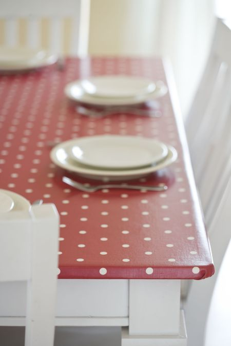 oilcloth covered kitchen table - this is a brilliant idea, especially with a baby in the house