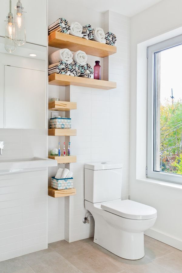 Different size shelving can add character and personality to a space that usually stays pretty dull. Like the powder room, for instance. This fun shelving idea adds extra style to a very unsuspecting place (and it's functional!)