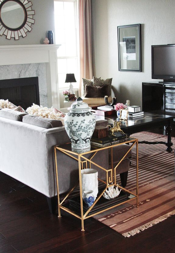 Chic, and done so on a budget, really should check out all the pictures of this room at Jenny Komenda Interiors. Really great design and this picture only shows you a small portion of the elements.