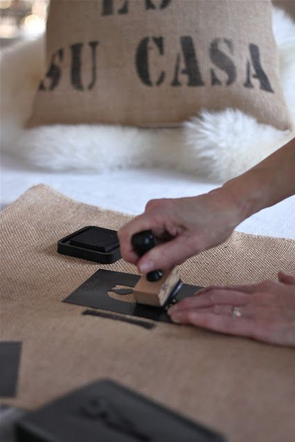 create outdoor pillows/cushions out of old coffee bean bags and print our initials?