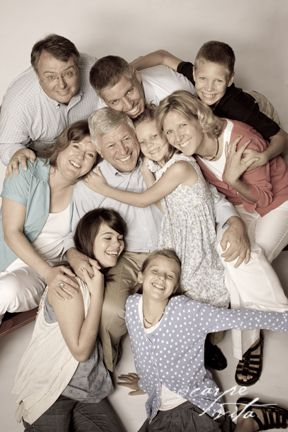 "The tight shot and ""snuggled"" family creates a warm, tight knit, effect with to this family portrait."