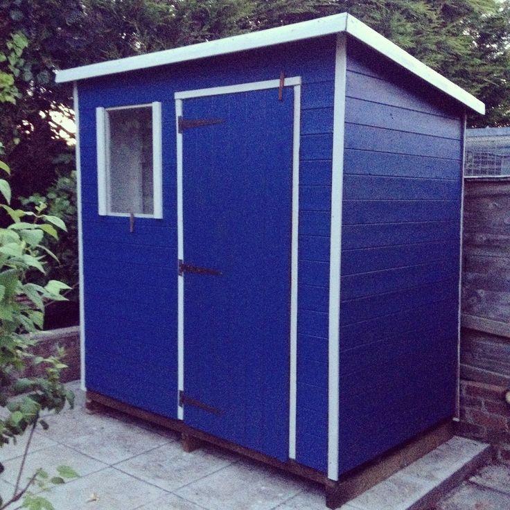 Beach hut style shed.
