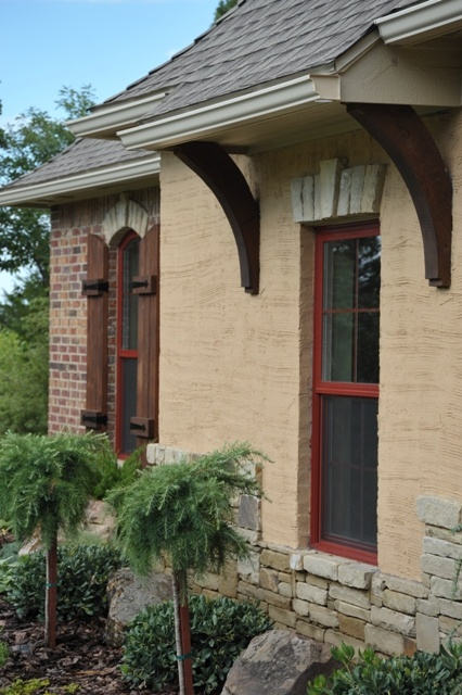 Overhang and wooden brackets stucco mixed with brick and for Exterior house brackets