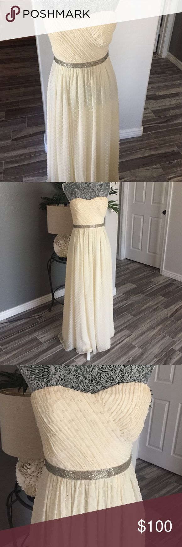 Ivanka trump dress Classy beige sheath dress with attached beaded waist belt. Never used. Size 4 perfect for any special occasion Ivanka Trump Dresses Strapless
