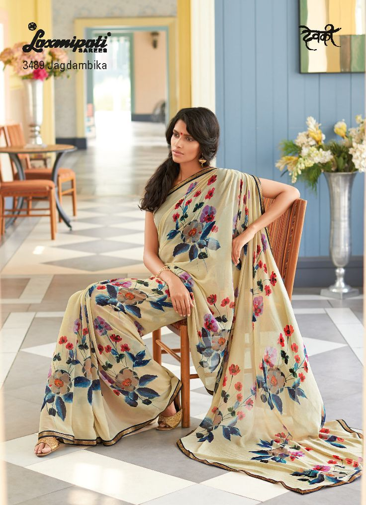 """""""Simplicity is the form of ultimate sophistication"""" - embroidery fancy lace with burlywood floral print saree truly proves this quote. Contrast blue pashmina fabric blouse is including with the saree."""
