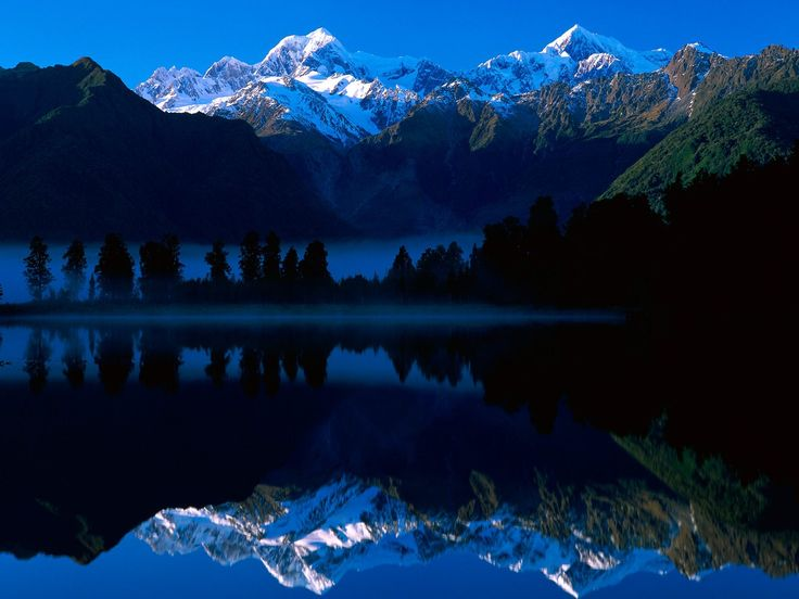 Lake Matheson reflects Mt Tasman and Mt Cook, New Zealand #Earthday2015