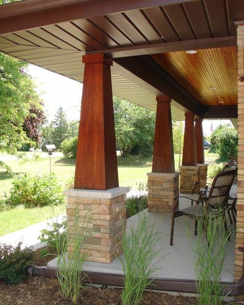 columns under deck/pergola. 1/2 wood, 1/2 stone to match the font of the house-straight columns instead of craftsman style though.