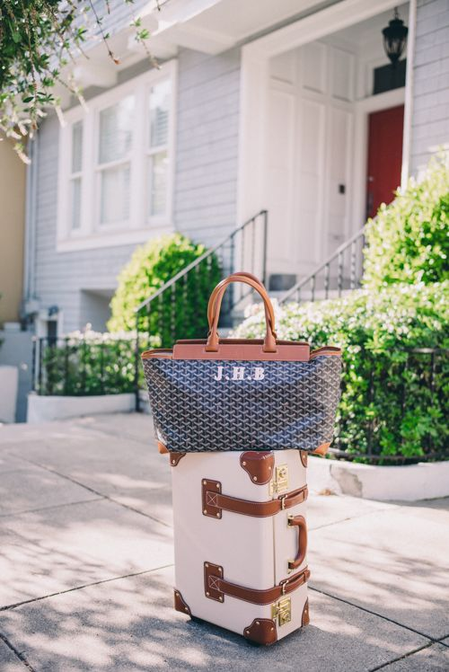 Gal Meets Glam Travel Style - Goyard Tote bag and Steamline Luggage carry-on