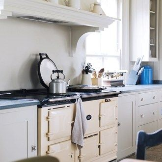 'This was our first  Aga, and even my husband is enamoured with the fact that he can pop things in there without having to preheat. It is electric, which is more economical than oil and allows better temperature control - one half functions like a conventional Aga, and the other is like a standard convection oven,' says the owner of  this kitchen designed by Plain English.