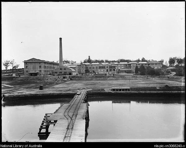 """Nestle's Factory seen from company wharf at Abbotsford, on the Parramatta River in 1918.Nestlé then known as the Anglo-Swiss Condensed Milk Company,purchased Abbotsford House and its grounds in 1917 to build the :largest chocolate factory in the Southern Hemisphere"""". Abbotsford House was retained for use as offices,while the factory was constructed on three sides of the house.   •National Library of Australia•   🌹"""