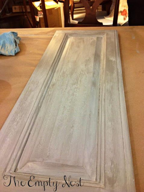 French Linen base, then generous amount of clear soft wax, while wax is wet apply a wash of paris gray and old white. same recipe used in annie sloan color recipes armoire with blue inside