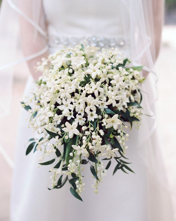 This bride carried a full lily of the valley and stephanotis bouquet from Amaryllis Designs down the aisle.