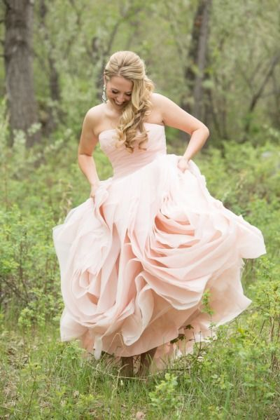 Ah, the joys of wearing an expensive, huge ball gown in a rural setting. I love outdoor weddings, though, so more power to her! :)