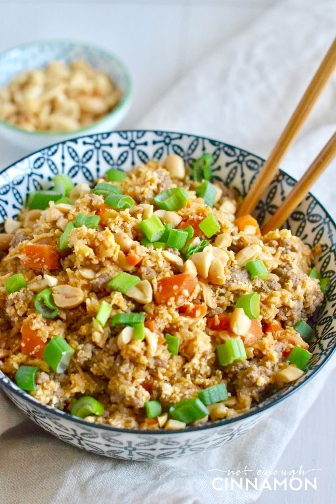 Asian cauliflower fried rice - so tasty and healthy! The perfect clean eating dinner you can devour without feeling guilty! Find the recipe on NotEnoughCinnamon.com