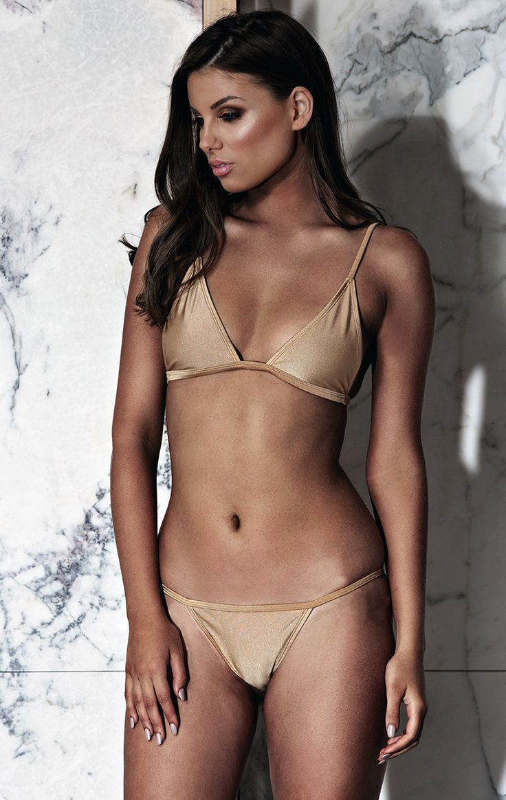 The 'Ibiza' bikini is designed to shine in the summer sun through its gleaming fabric. Its style best described as simple yet striking. Show off your best assets this summer with this daring minimalistic fit. Available in Bronze, Nude and Gold.