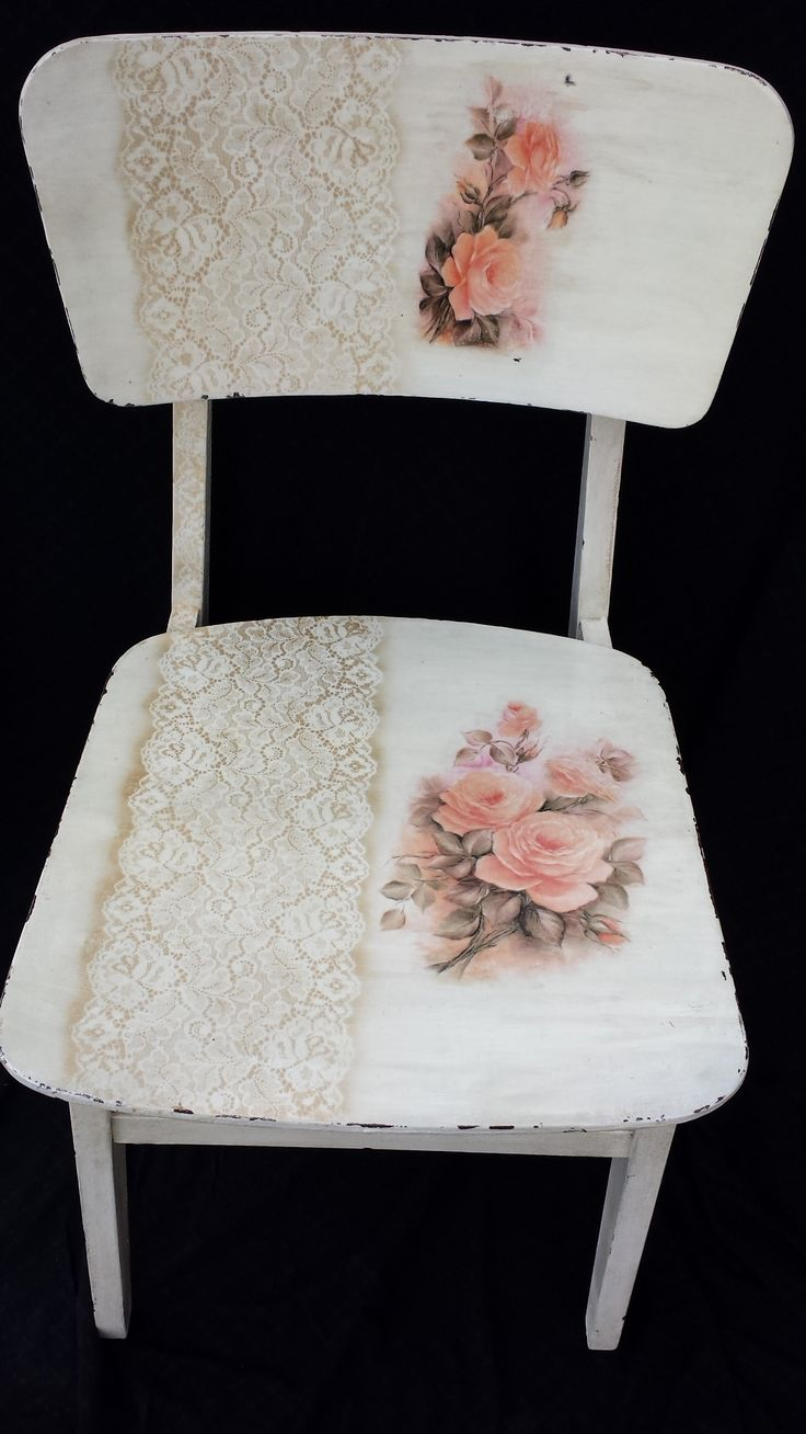 Painted-on flowers and lace turn this simple white chair into a beautiful rustic, french country piece.