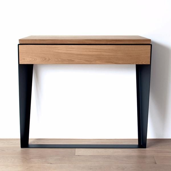 Witamina D's modern Mina console table was designed for use in small spaces, with a shallow depth of just 21cm, and a single drawer. Solid oak and black metal combine...