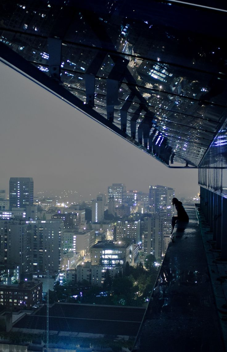 ((Samantha/open)) I sit on the ledg of a balcony atop a building in the middle of the city. There was a beautiful night. I was singing at myself, in a strange language. You walk up behind me.