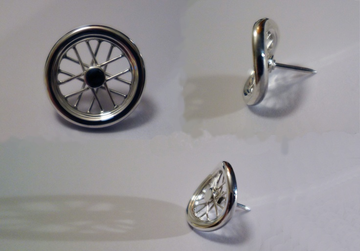 Handmade silver pin. Twisted bicycle wheel to symbolise the rollercoaster of life. Made by Ailin Roelvaag.