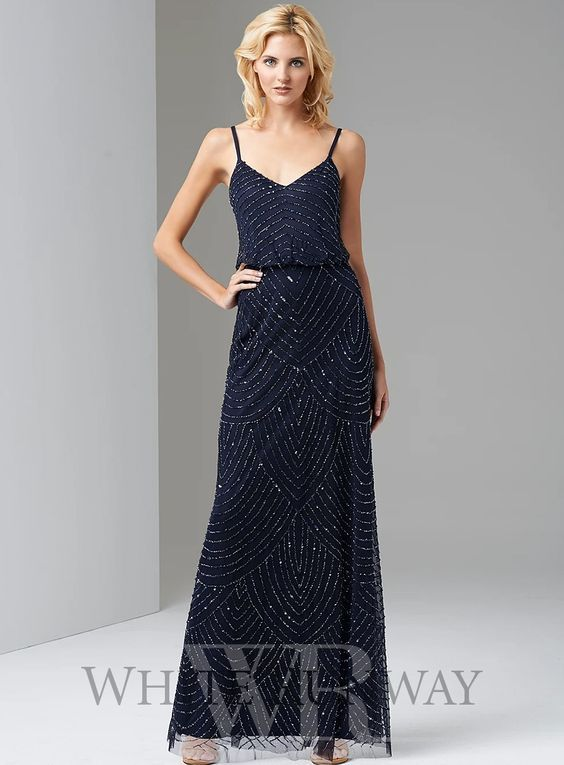 Rihanna Beaded Gown. A stunning full length dress by Adrianna Papell. Perfect for formals, black tie events and wedding guests. A flattering style with a loose fit bodice and sequin beaded detailing throughout.