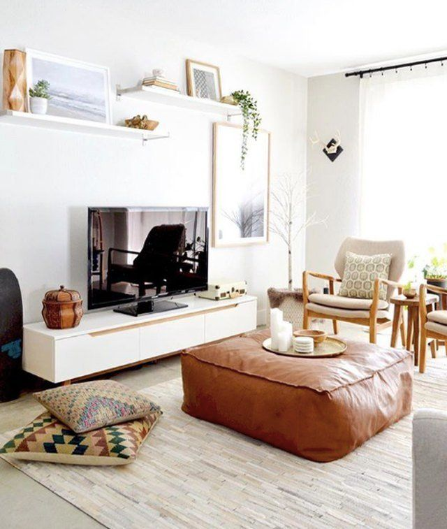 An Ottoman Turned Coffee Table Creates A Cozy Living Room Cozy