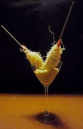 Spiedini di gamberi in pasta kataifi su mousse di melanzana