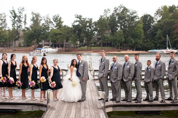 Navy bridesmaids dresses   gray groomsmens tuxes %u2013 This is Chelseas color scheme, but with coral as the accent color.
