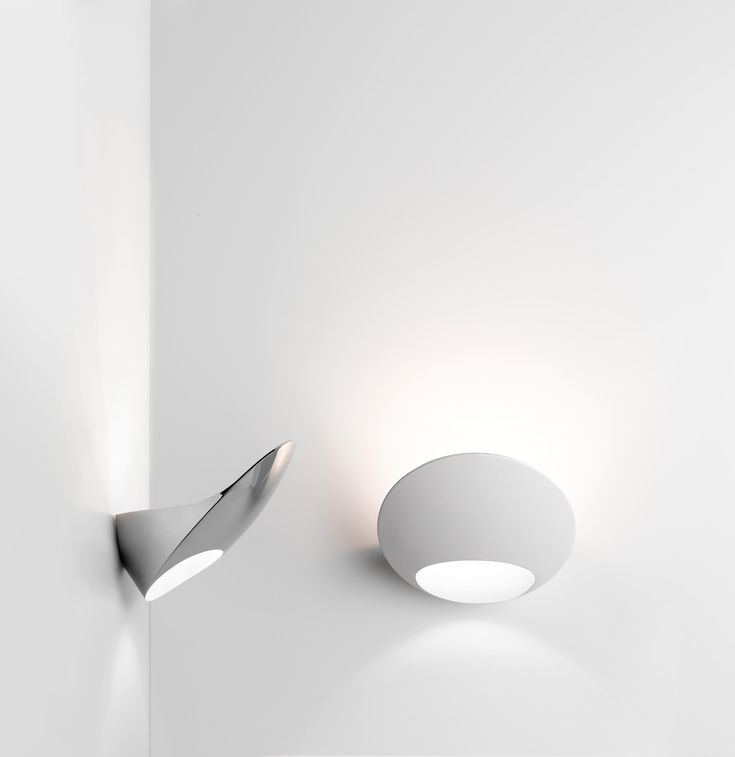Garbí Is A Wall Lamp, A Single Solid Volume Made Of Soft, Regular Surfaces  That Meet To Create Precise Edges. The Indirect Light From The LED Source. Awesome Design