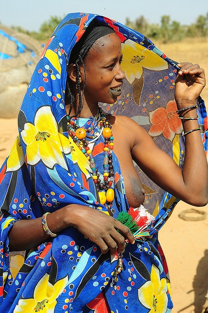 Africa |  Portrait of a woman who lives in a small hut in the bush in North Mali | © Luca Gargano