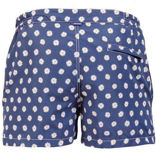 HARRIS SWIM SHORTS WITH DAISY PRINT Blue HARRYS Swim Shorts, with contrast all-over daisy print. Two side pockets. Small front pocket with Saint Barth embroidery on the flap, and concealed snap button. Zippered back pocket. MC2 Saint Barth brand patch on waist to the reverse. Zipper and magnetic closure with interior button. Semi-elastic waistband with elastic inserts at lateral side. Internal net. COMPOSITION: 100% NYLON. Model wears size M, he is 189 cm tall and weighs 86 Kg.