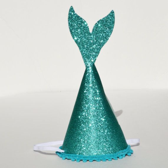 Always be a mermaid! Let your little ones rock the cutest mermaid party hat around featuring premium gold glitter paper, pom poms, and a fun mermaid tail! Hat has thick quality elastic for a comfortable fit on your Childs head. Party hat is about 6 inches tall. Please message me if you need any customizations such as color, size, or custom details. **This item is made to order and can be customized, please include all details in buyers notes when ordering**  We are able to make matching…