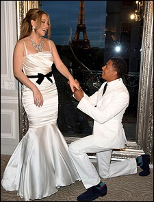 Almost four years after their surprise wedding in the Bahamas, Nick Cannon got down on one knee before Mariah Carey in a reported vow renewal ceremony on a Friday night in Paris. With the Eiffel Tower as a backdrop, Carey is seen in photos beaming in a stunning white mermaid dress with spaghetti straps and a black bow at the waist as Cannon, in a white suit and black tie, locks his eyes with hers.