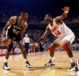 David Robinson (in black) guarded by Hakeem.  Amazing and a class act!