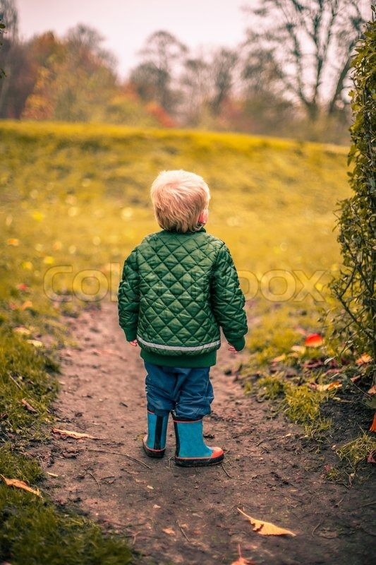 Stock image of 'Lonely boy in a garden at autumn'