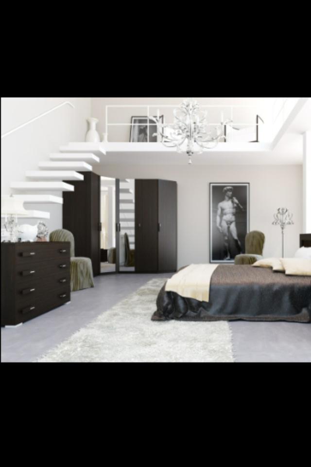 Lichte muren en vloer en donkere meubels