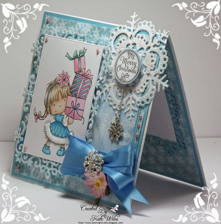 Handmade Christmas Card using New Release from Wild Rose Studio Dies - Snow Frame and Lacy Snowflake (New Release) Papers - Frosted Lace (New Release) Image - Girl with Xmas Presents (New Release) Sentiment - Christmas Labels Downrightcrafty