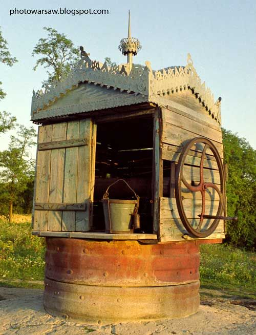 A village in Ukraine - the beautiful water well, with finely carved wooden top. The well is located on the main road in one of the villages.