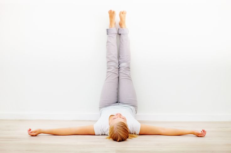 This is a mild inversion (a pose in which your body is turned upside down, reversing the effects of gravity). This one also helps with headaches, leg aches, and lower back issues. To get into the pose, lay down near to a wall. Once you are horizontal, put your feet in the air and wiggle your way close enough to the wall that your legs are nearly straight up. Your bum doesn't need to be exactly against the wall, but try to get as close as possible.