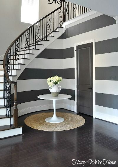 Bold stripes under the stairs & tips for getting clean, crisp lines // Honey We're Home