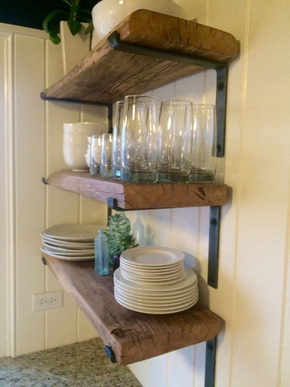 reclaimed lumber shelves with handmade steel brackets