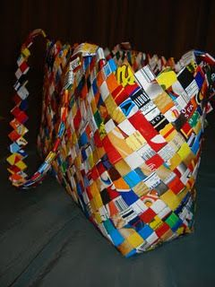 instructions for you to make a wrapper purse using recycled materials such as candy wrappers, chip bags and even paper.
