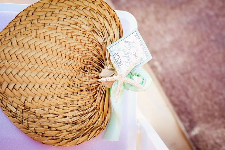 Fun destination wedding ideas: have fans for each guest at their seat with a note (Fine Art Studio)
