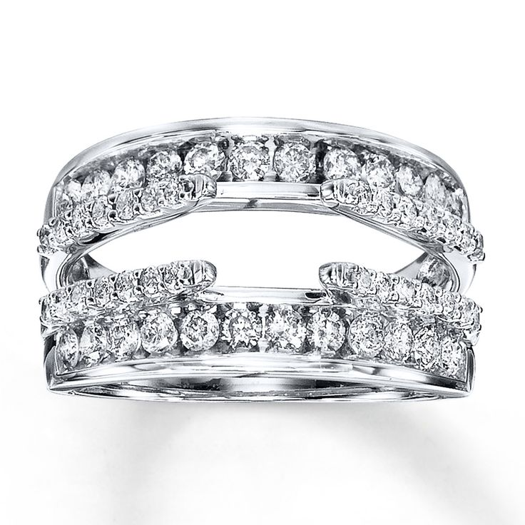 Inner and outer rows of round diamonds provide stunning brilliance above and below your solitaire in this exquisite 14K white gold enhancer ring. The total diamond weight of this fine jewelry enhancer ring is 1 carat. The diamond solitaire is sold separately. Diamond Total Carat Weight may range from .95 - 1.11 carats.