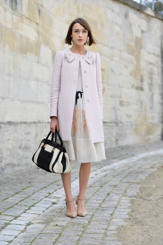 Gorgeous pastel dress with black ribbon, chic coat dramatic black and ivory bag!