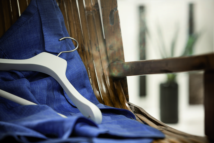 Extra white and matt wooden hanger from the Italian Classic Collection Credits: Sartoria Diletto Ph. paolo Bellon