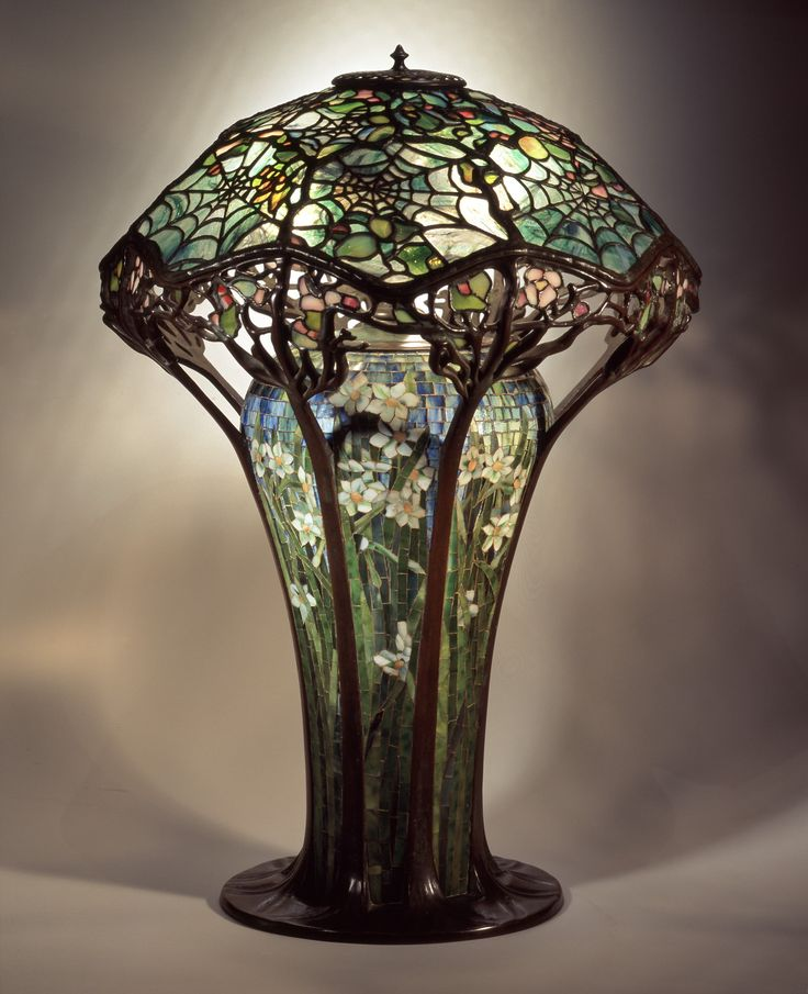 Library lamp, c. 1900. No. 146, Cobweb design shade, mosaic floral base [oil lamp conversion]; leaded glass, mosaic, bronze; Tiffany Studios, New York City, 1902–32; H. 30 in. (62-020).