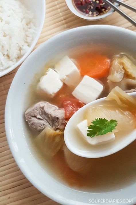 Salted vegetable tofu soup with pork ribs and tomato. A delicious and appetizing home-style Chinese soup.