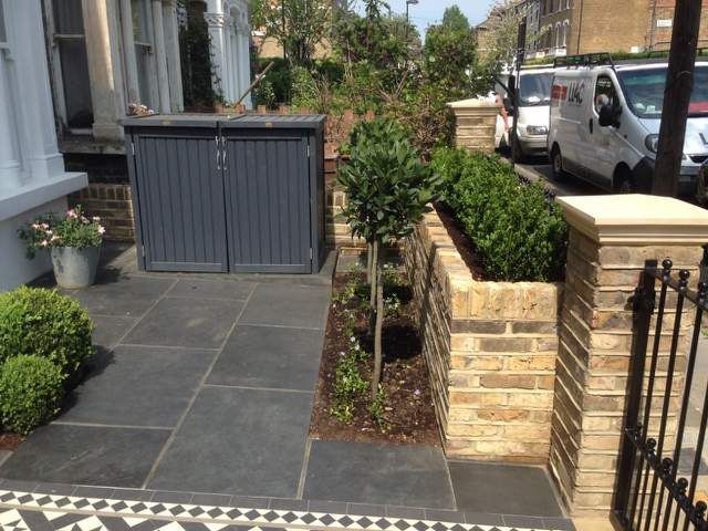 raised bed front garden wall london bin store topiary bay trees buxus